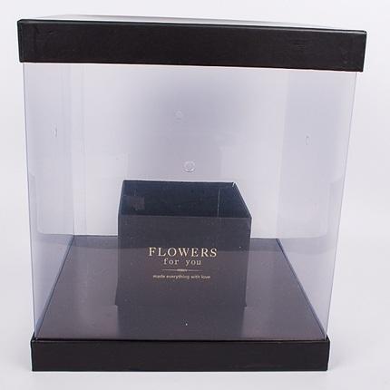 Цветы в прозрачной черной коробке